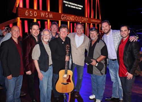 L-R: Shenandoah's Shane Chilton, Jamie Michael, Stan Munsey, Donnie Allen, Marty Raybon, Grand Ole Opry's Pete Fisher, Shenandoah's Mike McGuire, SiriusXM's J.R. Schumann, Johnstone Entertainment's Cole Johnstone