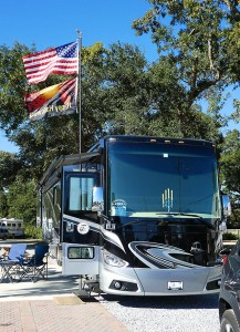 The RV is parked at Five Flags with a Halloween flag flying and a creepy candelabra in the window
