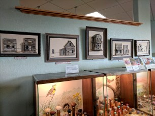 Using tiny pieces of petrified wood to create art of historic buildings