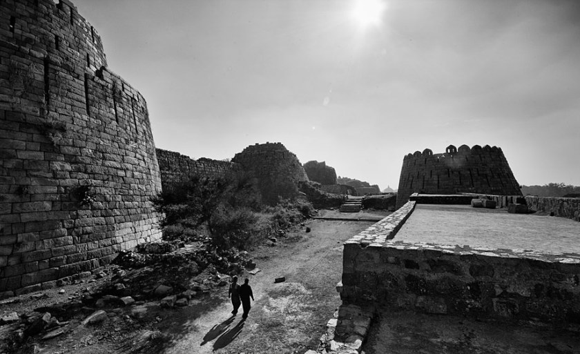 Tughlaqabad Fort is a ruined fort in Delhi, stretching across 6.5 km, built by Ghiyas-ud-din Tughlaq, the founder of Tughlaq dynasty, of the Delhi Sultanate of India in 1321, which was later abandoned in 1327. Photo: Shahidul Alam/Drik/Majority World