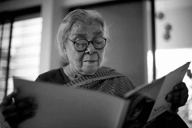 "Mahasweta Devi looking at photo exhibition catalogue ""Nature's Fury"" by Shahidul Alam/Drik/Majority World"