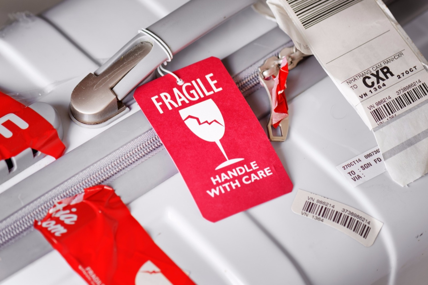 mark your suitcase as fragile - top travel hacks