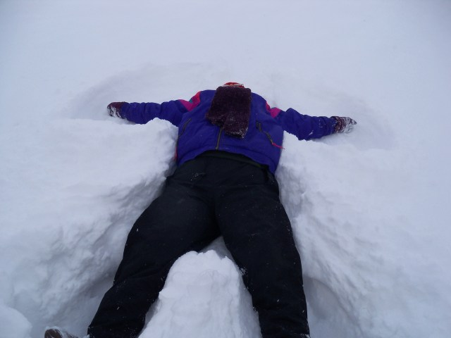 Laurel, finally getting to make a snow angel.