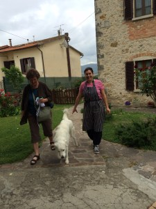 Nancy and Giulia leave the house with Noa dog escorting them.