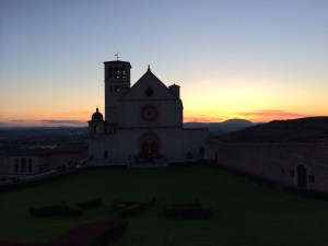 The basilica is outlined during the sunset in Assisi.
