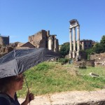 Shirley creates her own shade against the relentless Roman sun.