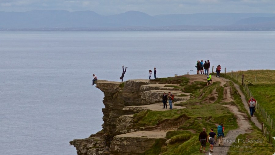 Dangerous handstand at The Cliffs of Moher, Co. Clare, Ireland