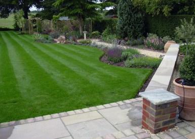 Spacious patio allows plenty of room to sit and enjoy the views down the gardenin this medium sized garden.