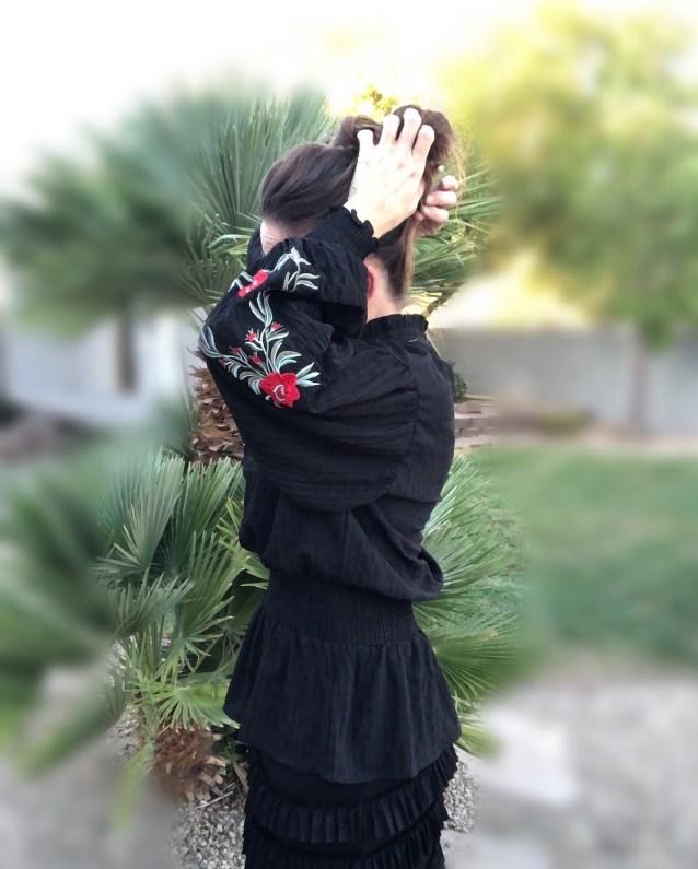 Black mock neck floral embroidered top