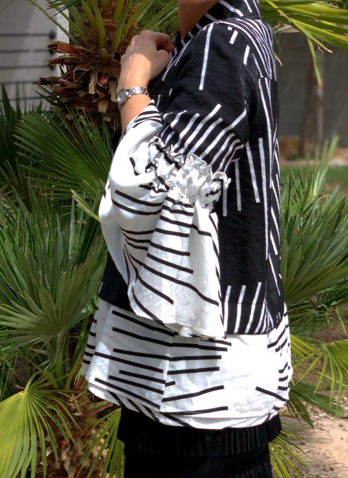 Geometric striped bell sleeve black white jacket