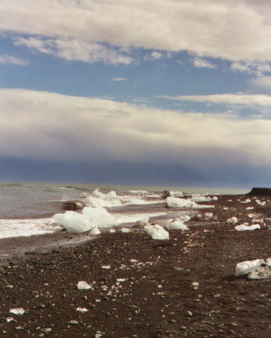 Some of the ice chunks only made it past the bridge before washing up on the black sand beaches. Note the incoming storm on the horizon.