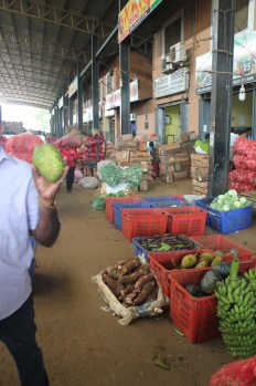 This was a commercial market, so farmers would come and sell their produce to these middlemen, who would then sell it to markets or other large consumers.