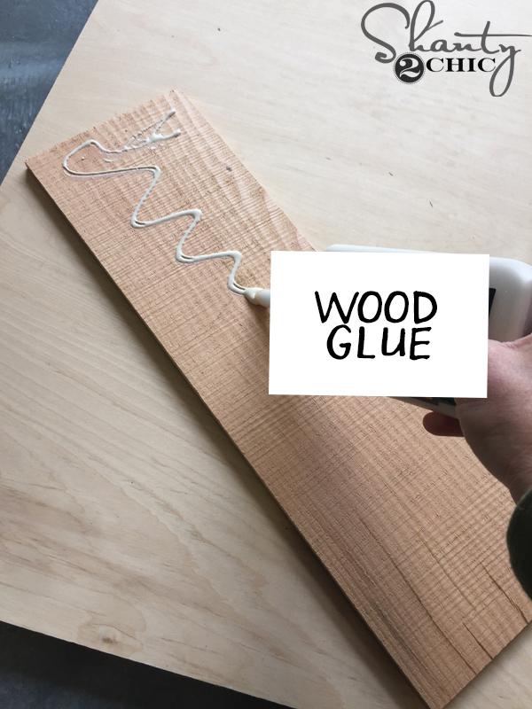 apply-wood-glue-to-back-of-barn-wood