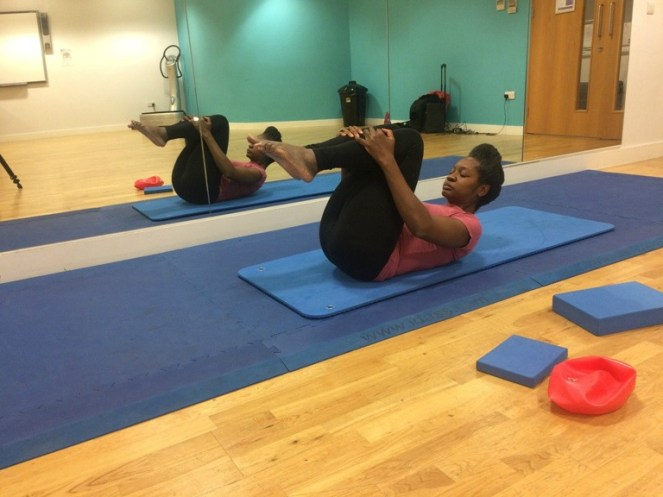 Strengthen core muscles Pilates rolling like a ball exercise