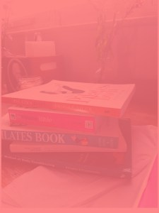 Pile of books on Pilates sitting on table