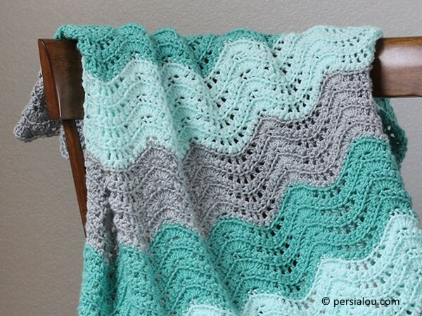 FEATHER AND FAN BABY BLANKET