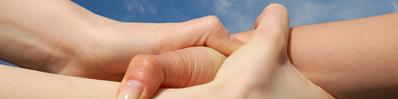 Helping Hands isolated against a blue sky