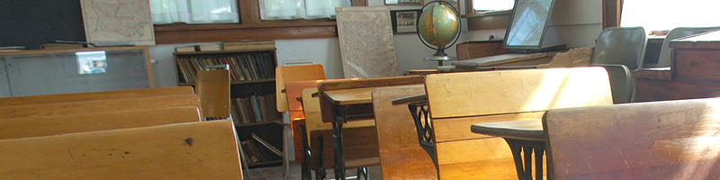 a recreation of a one-room school house using antiques in a museum.