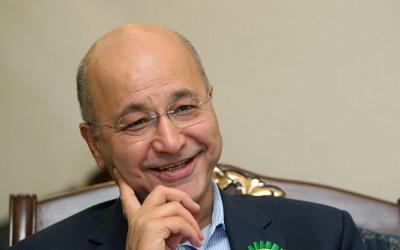 الرئيس العراقي يطالب بتمكين المرأة