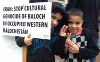Members of the Baloch community in the Pacific Northwest holding a peaceful protest in Seattle, Washington. Credit: Changiz Baluch.
