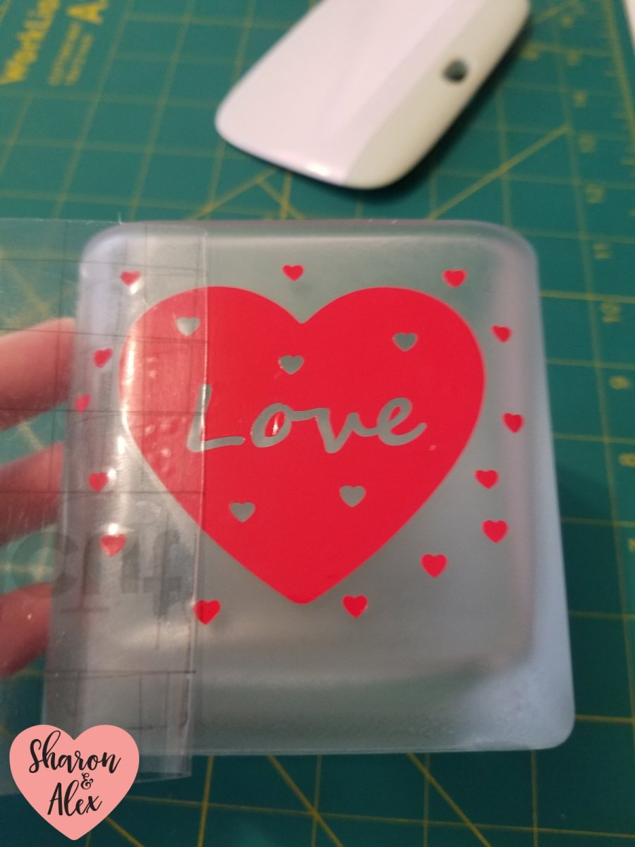 Remove transfer tape from surface