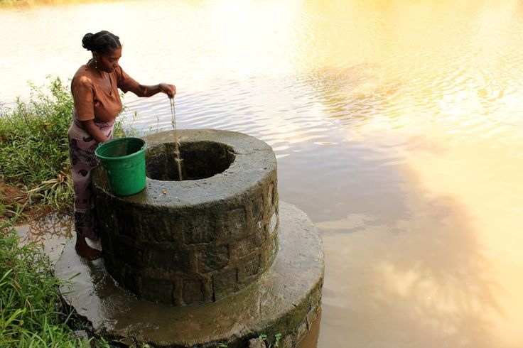 Madagascar-African-Woman-Fetching-Well-Water