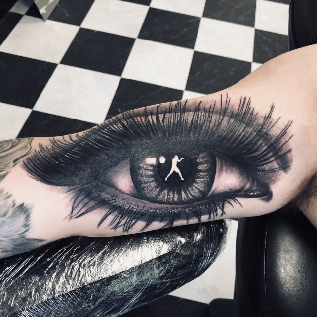 Beautifully detailed tattoo of an eye with a boxer in the pupil, done at Sharp Art Studios