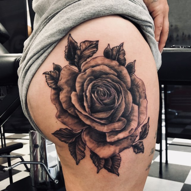 Big rose on the hip of a female done at Sharp Art Studios