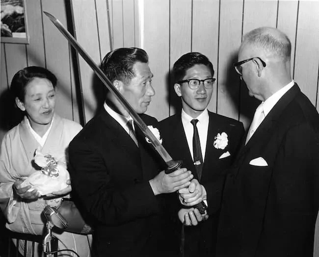 Japanese WW2 pilot Nobuo Fujita presents his family's sword to the mayor of Brookings in 1962.