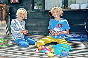 Two boys coloring Easter eggs