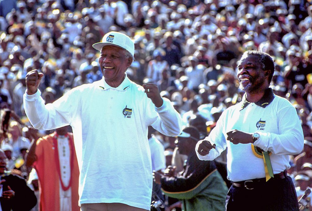 990601SH14 SAFRICA  : GOVERNMENT : ELECTIONS : PERSONALITY : MAY99 - President Nelson Mandela and Deputy President Thabo Mbeki dance the madiba jive at the Siyanqoba rally (we are winning) held at the FNB stadium in Soweto.