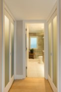 Hall closets have accent lighting.
