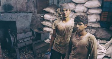 Two young plastic recycling workers at the Dharavi Slum