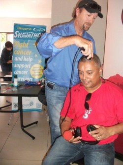 Shavathon Sanlam 2012 Aden Thomas of kfm 94.5 getting shaved
