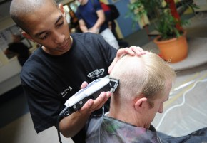 UCT Shaun Parsons of the College of Accounting is shaved by Jisreel Aries of CANSA