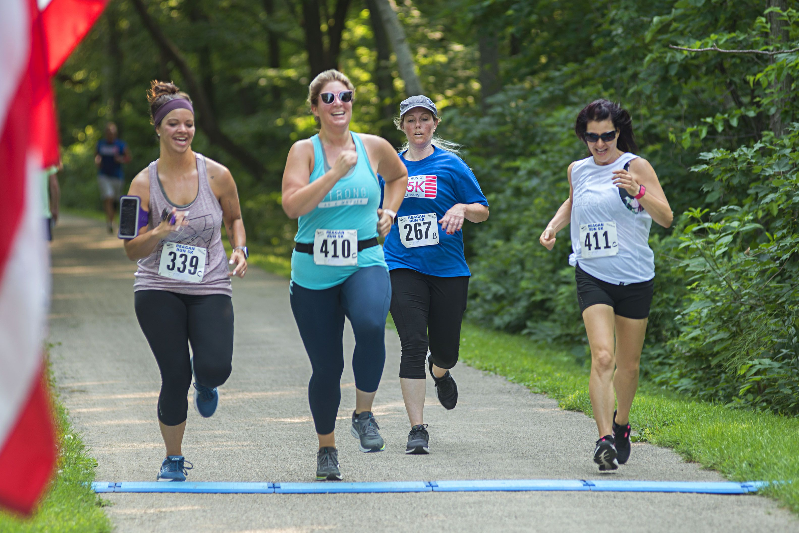 Kylie Stephens (left), Nikki Thomure, Melanie Wyatt and Brenda Van Horn cross the finish line Saturday.
