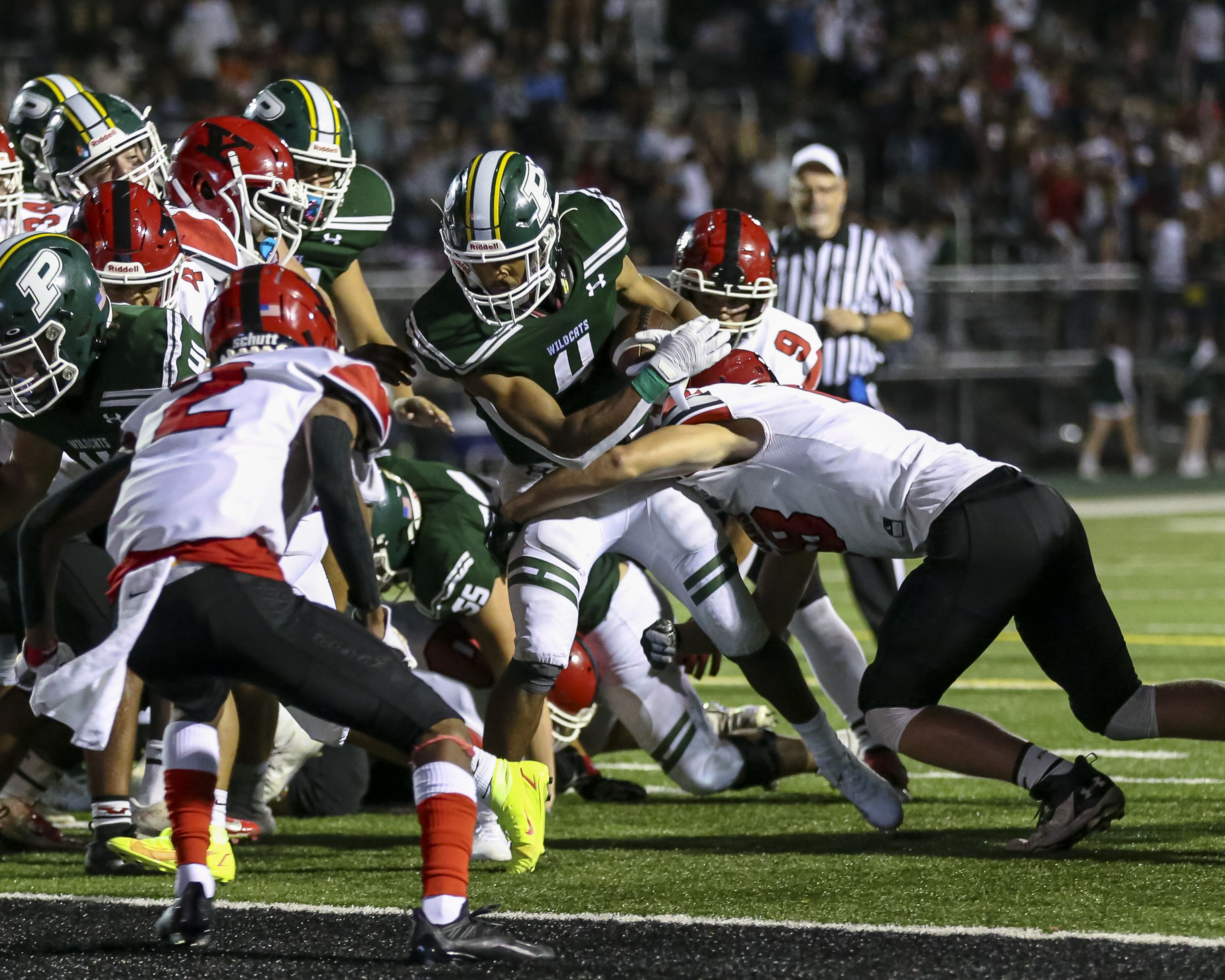 Plainfield Central's Aaron Larkins (4) scores a late touchdown during football game between Plainfield Central vs Yorkville.  Sept 2, 2021.  Gary E Duncan Sr. for Shaw Local.