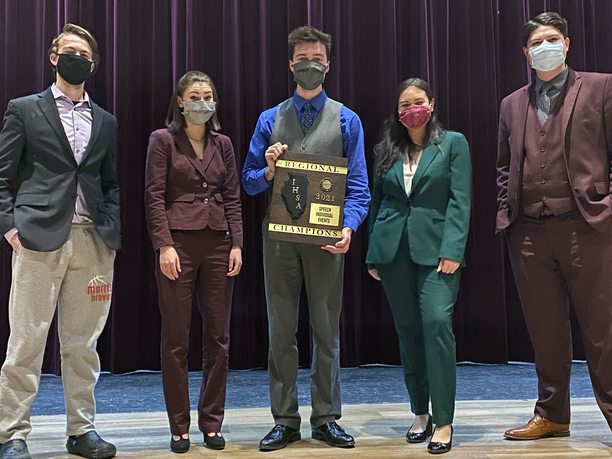 Morris senior speech team members Reagan McDaniel (from left), Molly Gustafson, Keaton Auwerda, Andrea Barron and Alex Duffy show off their regional championship plaque.