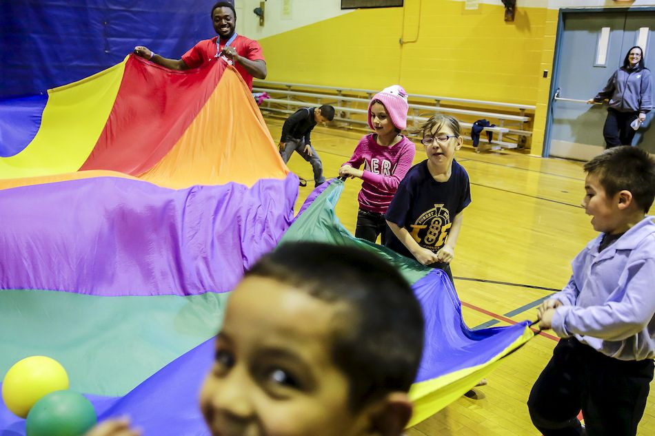 Children play a game during the Kidz Zone after-school program April 15 at the Smith Family YMCA in Joliet.