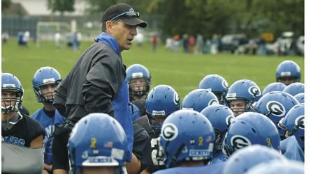 Chronicle file photo Geneva football coach Rob Wicinski gives his team a pep talk after a 2007 practice.