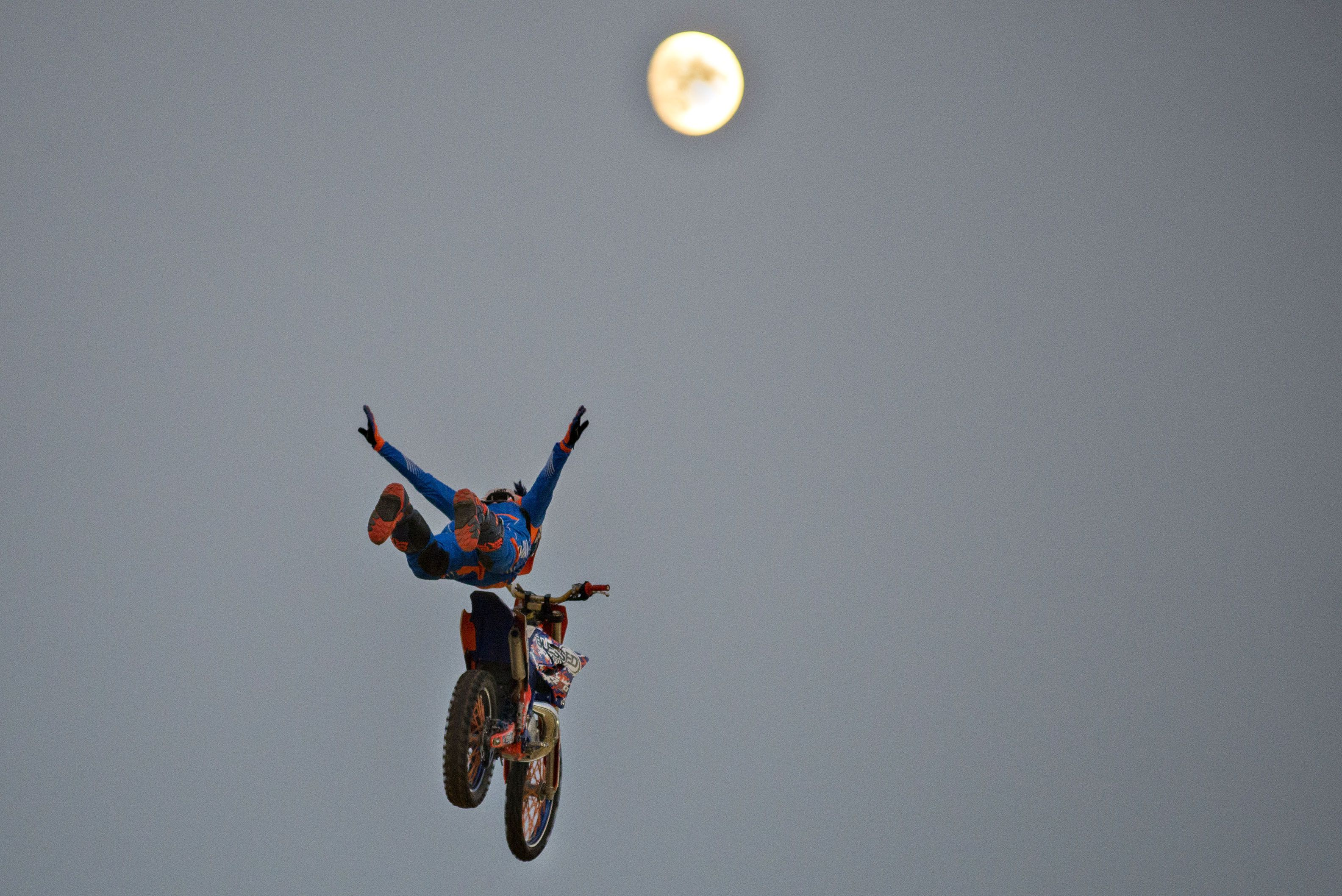 Ed Rossi, motorcross rider for Sick Air FMX, does his best superman impersonation, flying from ramp to ramp Thursday in Morrison.