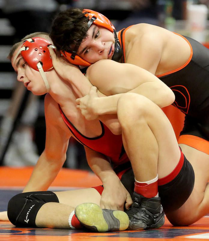 Lincoln-Way West's Javen Estrada wrestles Pekin's Ryan Haynes in the 138 pound 3A wrestlebacks during the IHSA individual state wrestling tournament on Friday, Feb. 21, 2020 at the State Farm Center at the University of Illinois Champaign-Urbana in Champaign.