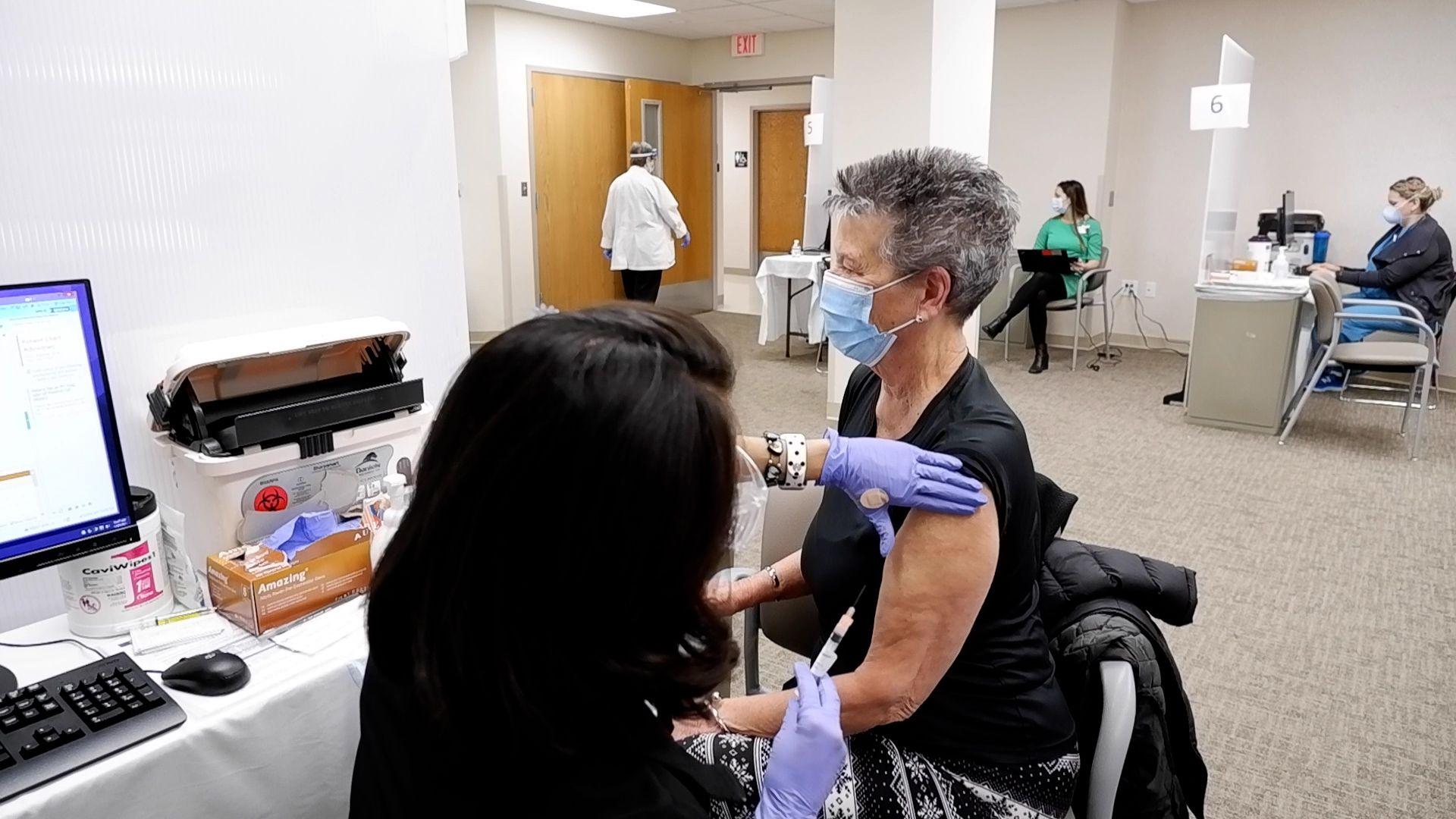 Woodstock resident Sandra Bradshaw prepares to receive the Moderna COVID-19 vaccine from nurse Gina Manon on Jan. 29, 2021, at Northwestern Medicine Woodstock Hospital.
