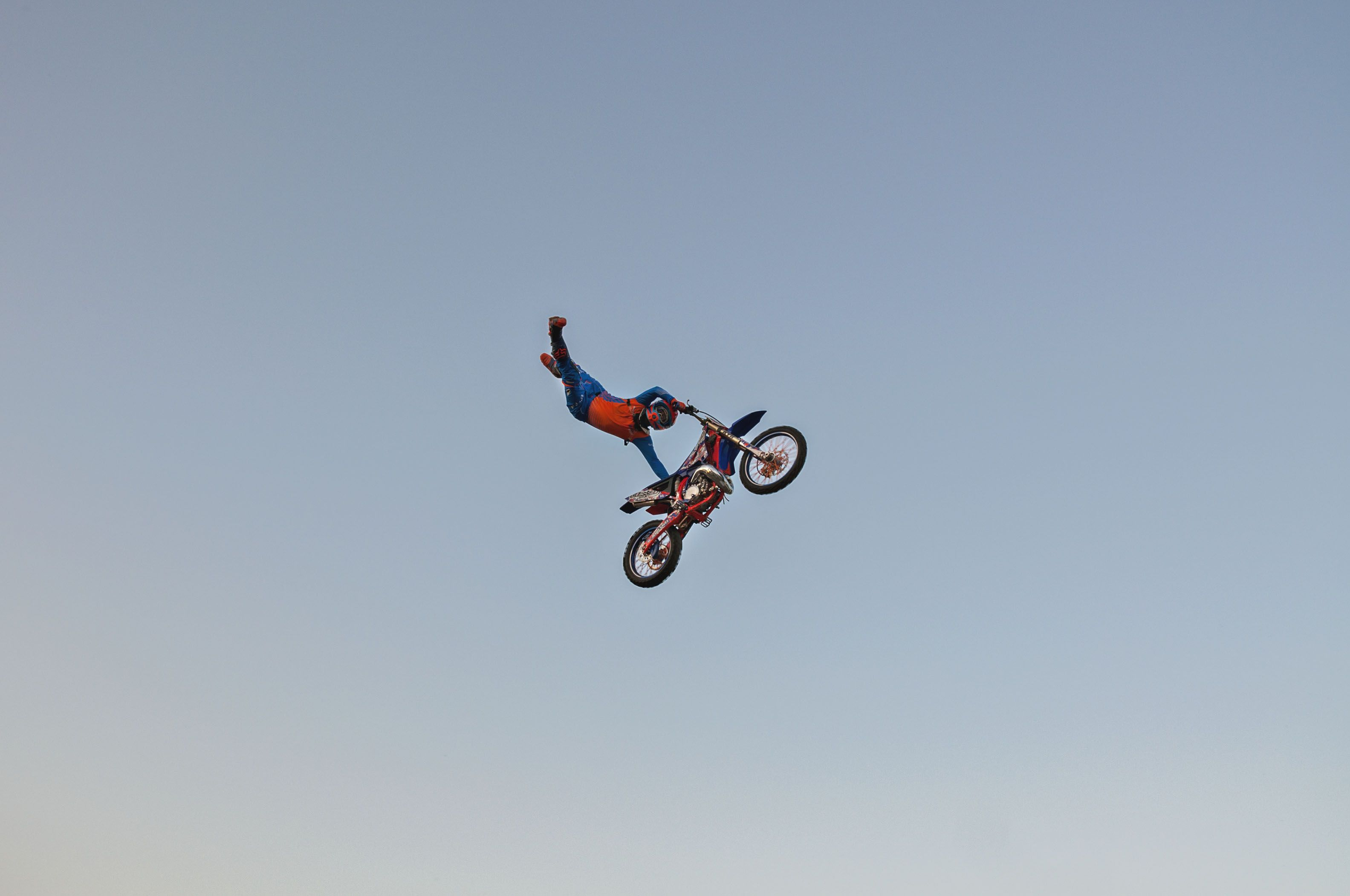 Ed Rossi, motorcross rider for Sick Air FMX, soars high above the grandstand at the Whiteside County fair in Morrison, Thursday, August 20, 2021 during a show at the fairgrounds. The stands were packed with visitors watching the flips, tricks and dirt bike stunts.
