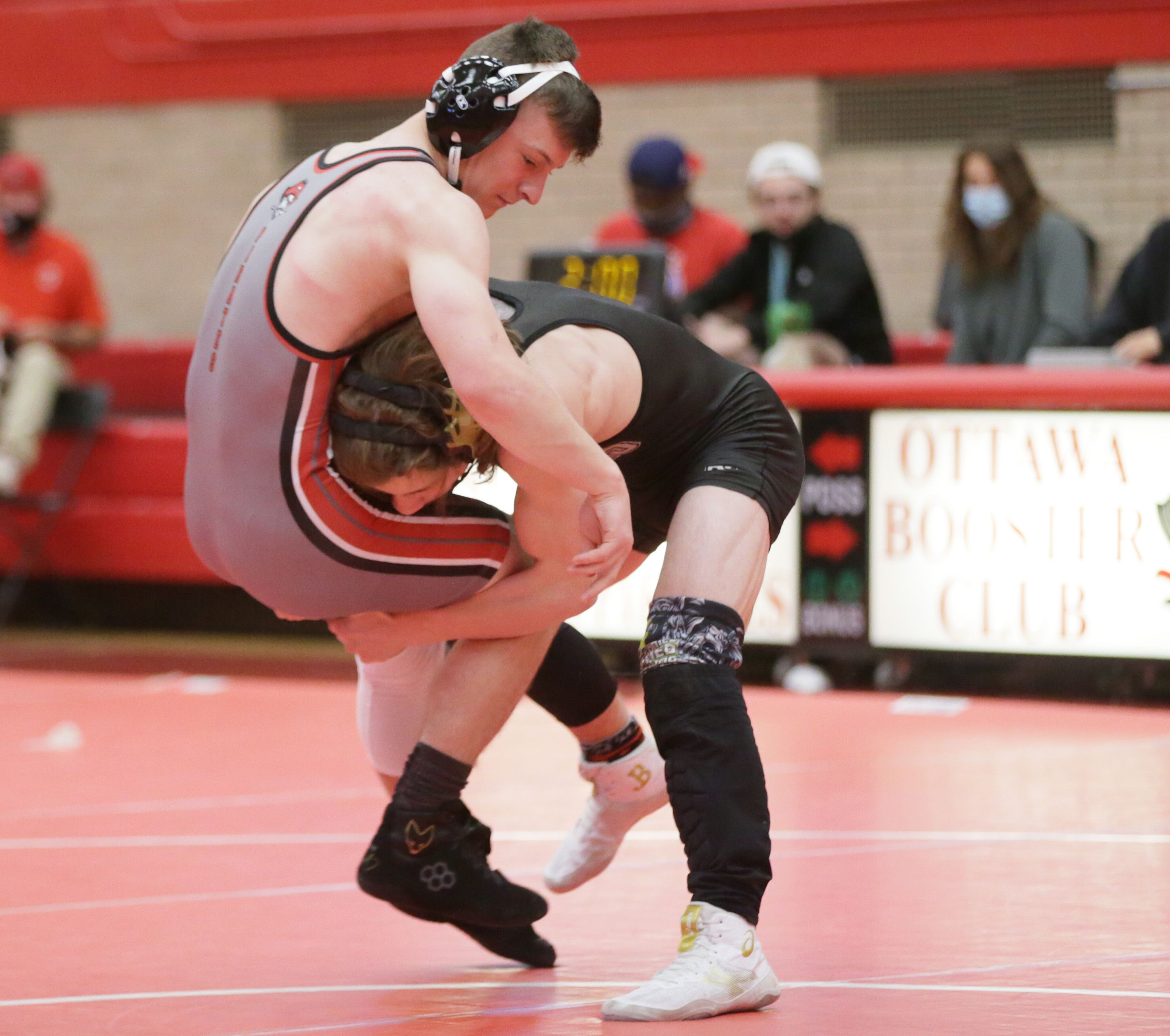 Sycamore's Brayden Peet lifts Ottawa's Hunter Wilson off his feet during a wrestling meet at Ottawa on Saturday May 1, 2021.
