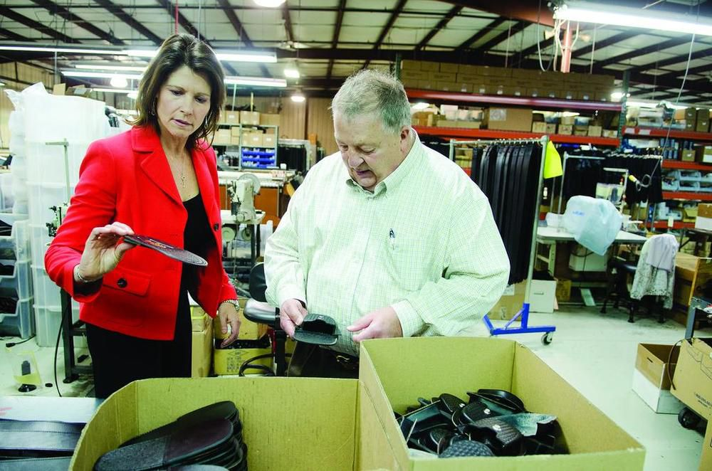 U.S. Rep. Cheri Bustos, D-East Moline, tours a business in May 2016.