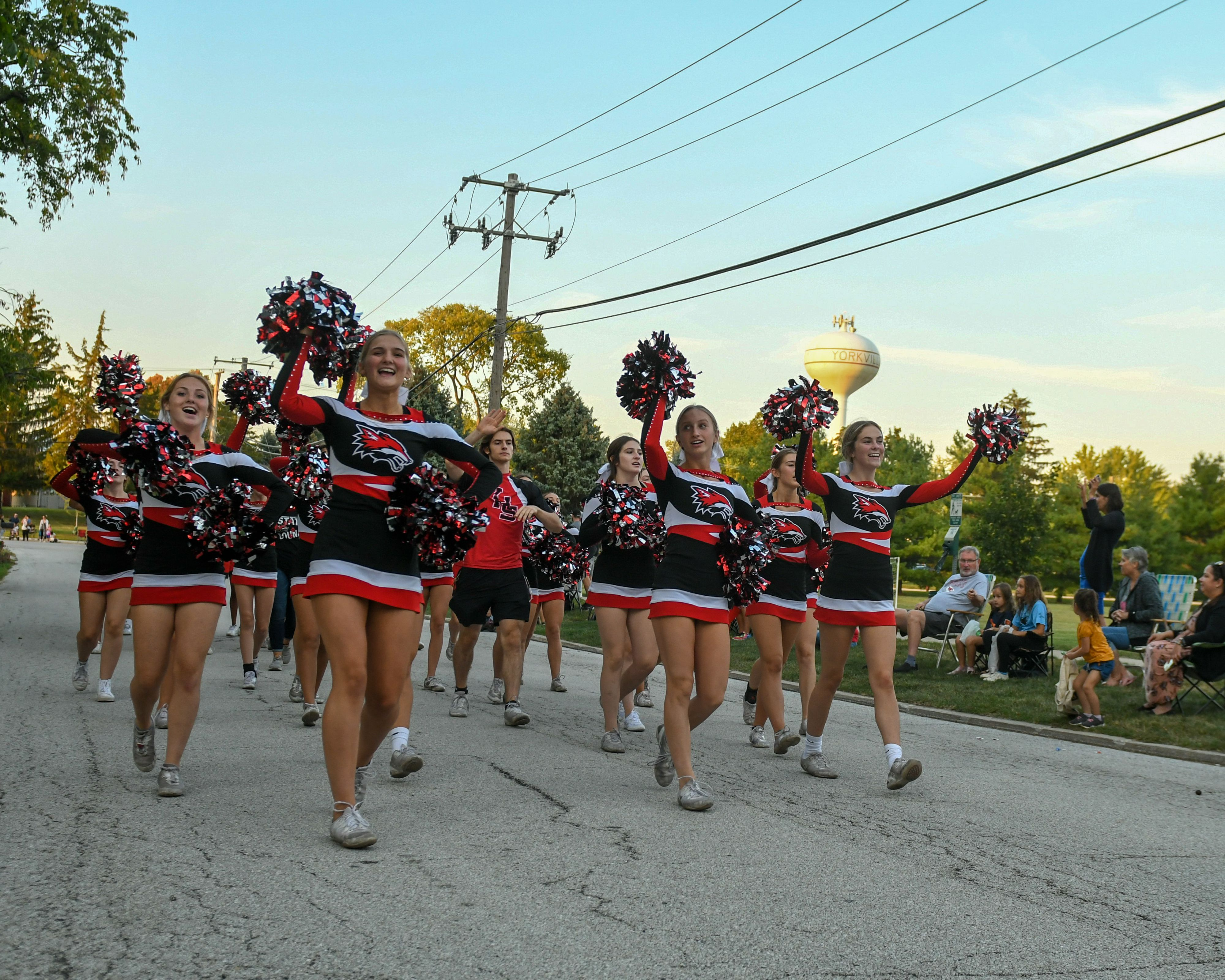 Yorkville Cheerleaders perform a cheer as they take part of the Yorkville homecoming parade  on Sept. 30.