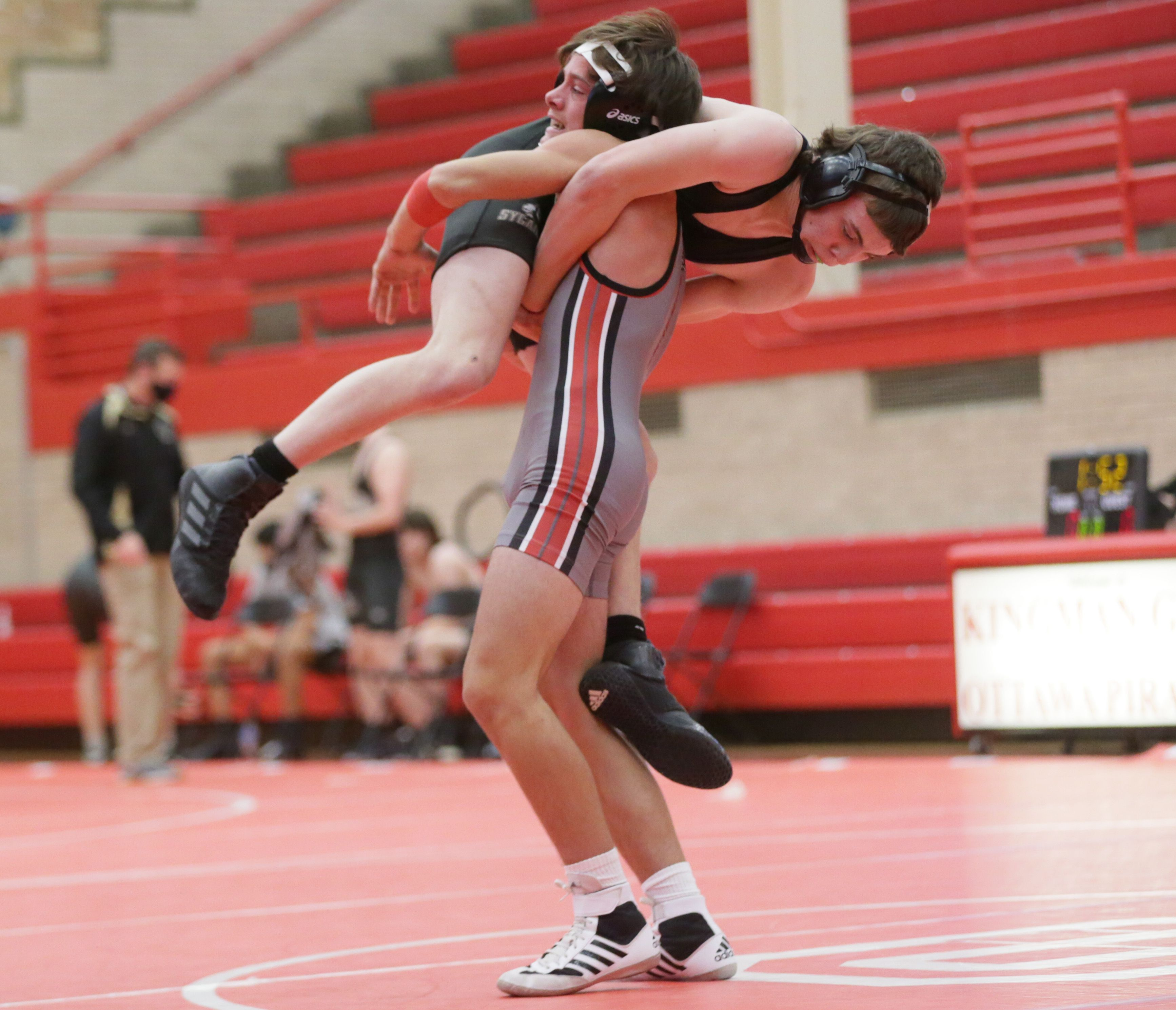 Ottawa's Grason Johnson lifts Sycamore's Trent DuMont off of the mat during a wrestling meet at Ottawa on Saturday May 1, 2021.
