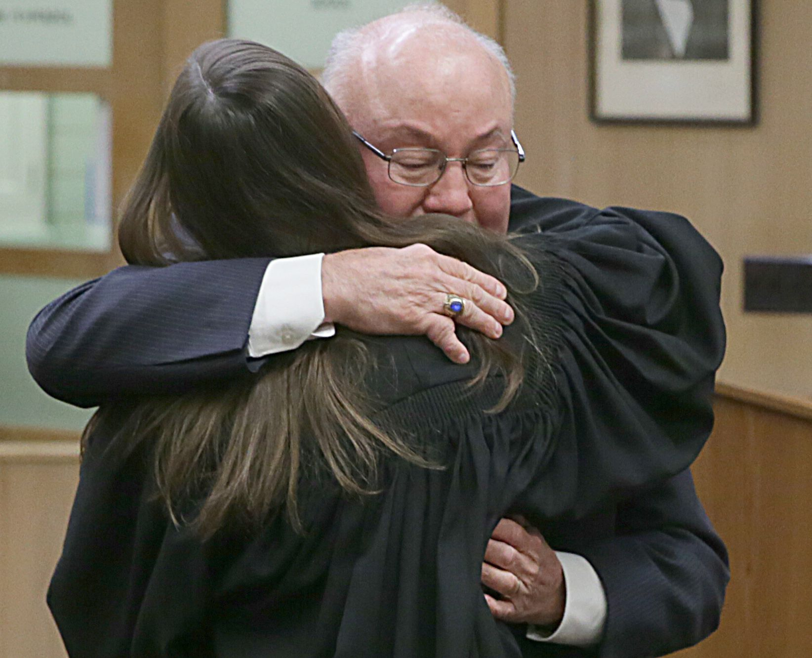 Attorney John Cantlin hugs his daughter Christina Cantlin-Van Winggeren after Van Winggeren was sworn in at the La Salle County Courthouse downtown Ottawa on March 22, 2021.
