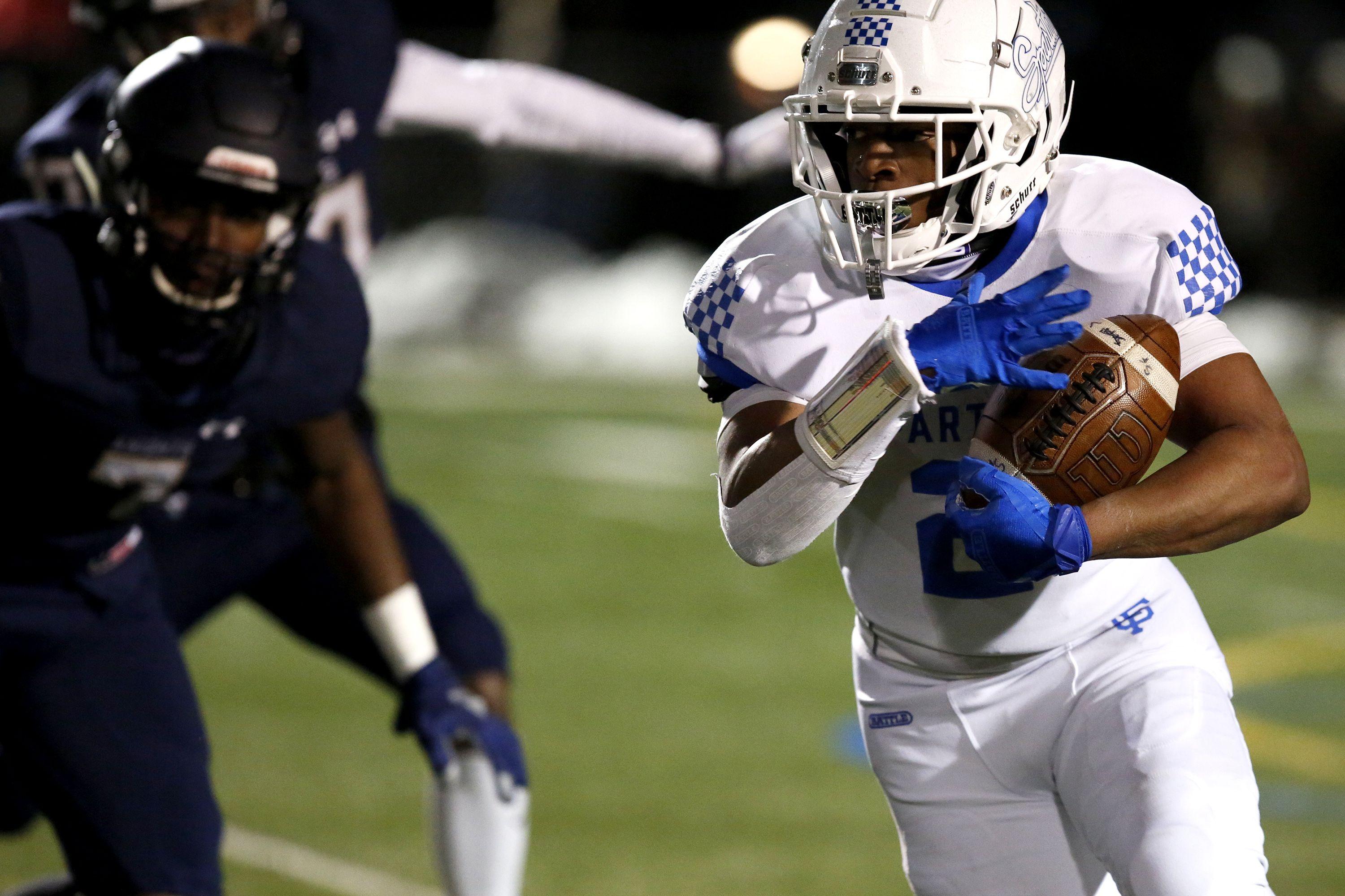 St. Francis' Terreon Roundy runs the ball during a Week 1 game against IC Catholic.